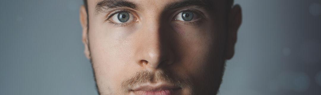 Image of young man gazing intently at camera