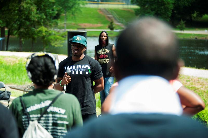 "Rwenshaun Miller speaks at his annual ""Let's Talk About It"" mental health awareness walk"