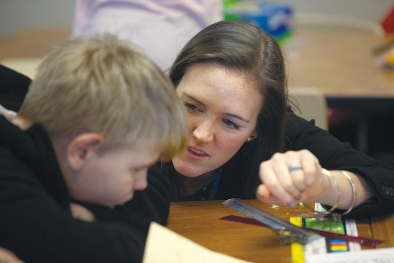 Caroline Clark teaching a young boy