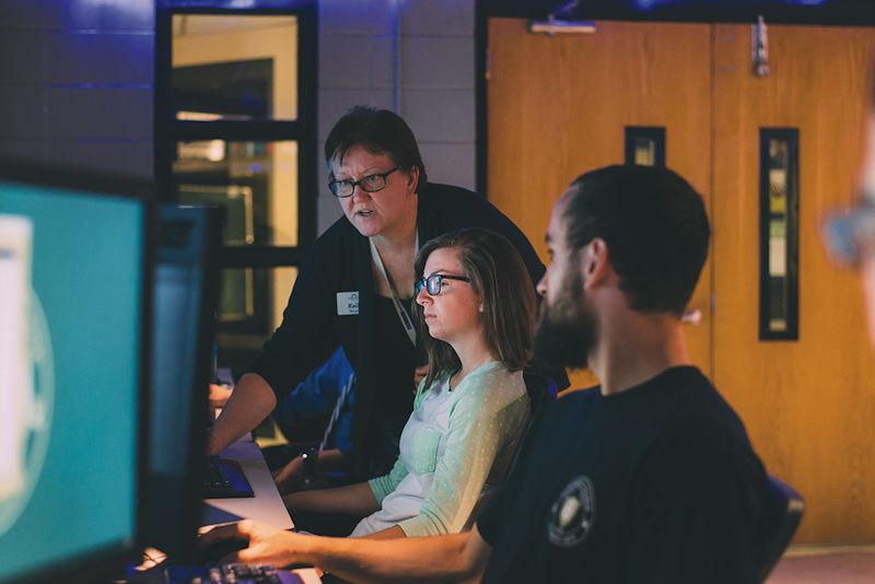 Montreat College cybersecurity students with cybersecurity professor Kelli Burgin